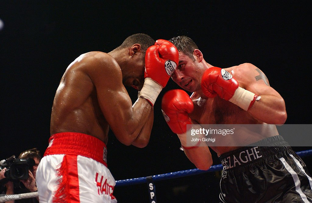 Joe Calzaghe attacks Charles Brewer on his way to retaining the WBO title in Cardiff, Wales. DIGITAL IMAGE Mandatory Credit: John Gichigi/Getty Images