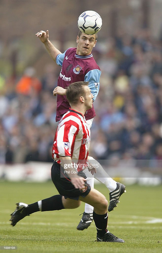 Joe Cole of West Ham heads the ball during the FA Barclaycard Premiership match between West Ham United and Sunderland at Upton Park, London. DIGITAL IMAGE. Mandatory Credit: Phil Cole/Getty Images