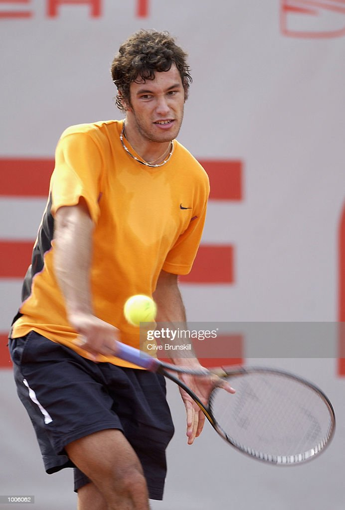 Jose Asasuso of Argentina plays a backhand during his second round match against Juan Carlos Ferrero of Spain during the Open Seat Godo 2002 held in Barcelona, Spain. DIGITAL IMAGE Mandatory Credit: Clive Brunskill/Getty Images