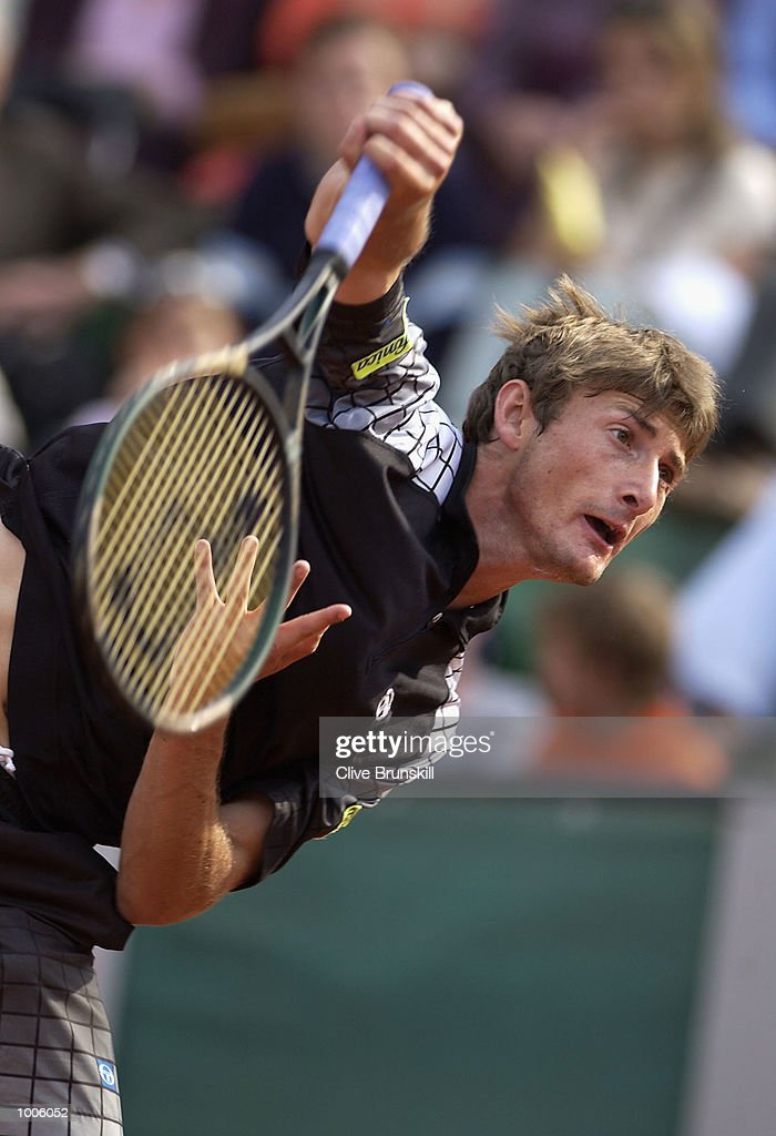 Juan Carlos Ferrero of Spain serves during his second round match against Jose Acasuso of Argentina during the Open Seat Godo 2002 held in Barcelona, Spain. DIGITAL IMAGE Mandatory Credit: Clive Brunskill/Getty Images
