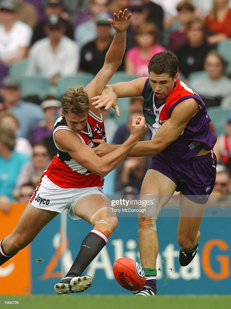 Justin Longmuir #20 for the Fremantle Dockers tackles Justin Koschitzke #24 for St Klida during the round two AFL match between the Fremantle Dockers and St Kilda Saints played at Subiaco Oval in Western Australia.Mandatory Credit: Tony McDonough/Getty Images