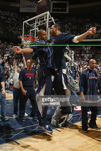 Kenyon Martin and Lucious Harris of the New Jersey Nets bump chests during player intros prior to the game against the Indiana Pacers at game 1 of...