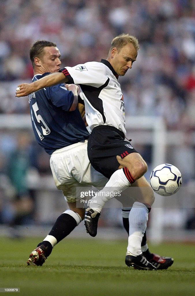 Kevin Nolan of Bolton Wanderers tries to tackle Bjarne Goldbaek of Fulham during the FA Barclaycard Premiership match between Fulham and Bolton Wanderers at Craven Cottage, London. DIGITAL IMAGE Mandatory Credit: Phil Cole/Getty Images