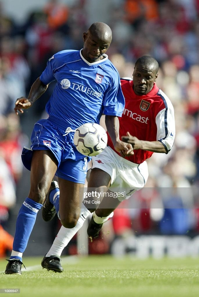 Lauren of Arsenal tries to tackle Finidi George of Ipswich Town during the FA Barclaycard Premiership match between Arsenal and Ipswich Town at Highbury, London. DIGITAL IMAGE Mandatory Credit: Phil Cole/Getty Images