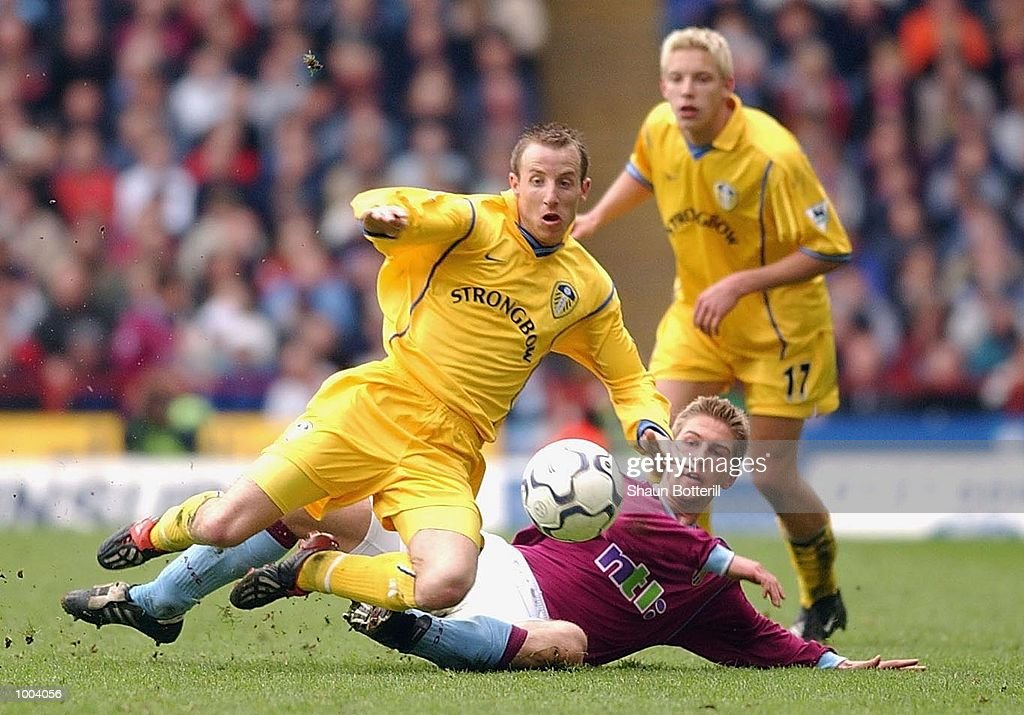Lee Bowyer of Leeds is challenged by Thomas Hitzlsperger of Villa during the FA Barclaycard Premiership match between Aston Villa and Leeds United at Villa Park, Birmingham. DIGITAL IMAGE. Mandatory Credit: Shaun Botterill/Getty Images