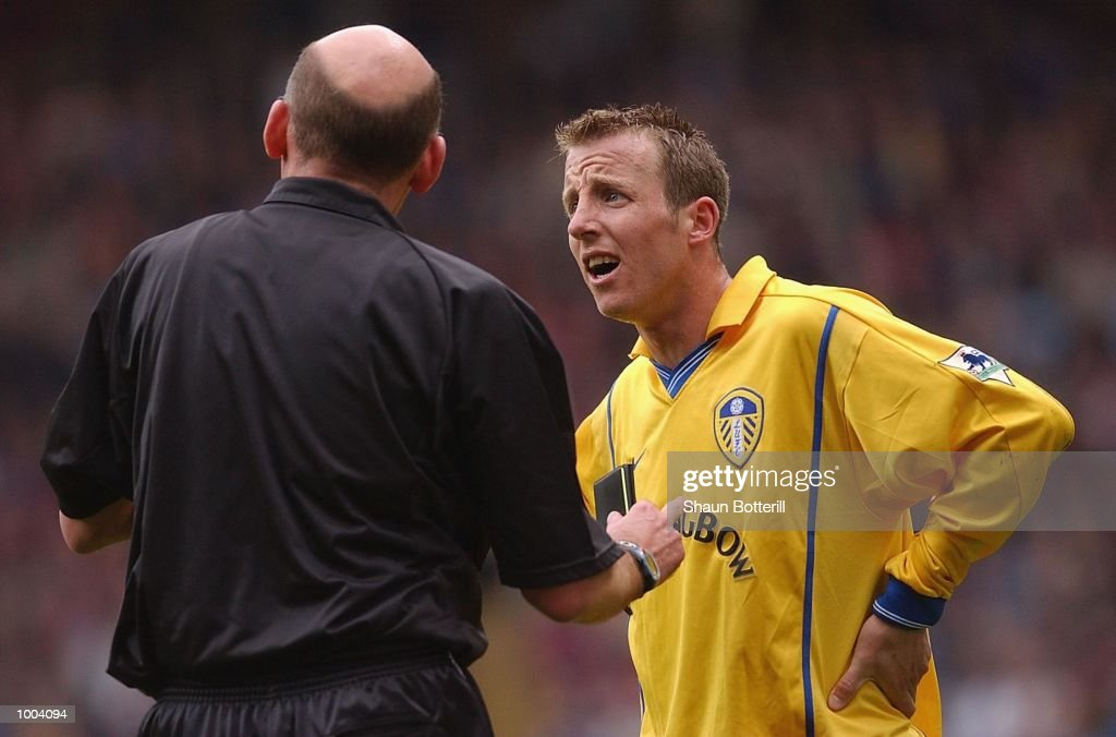Lee Bowyer of Leeds with the referee Barry Knight during the FA Barclaycard Premiership match between Aston Villa and Leeds United at Villa Park, Birmingham. DIGITAL IMAGE. Mandatory Credit: Shaun Botterill/Getty Images