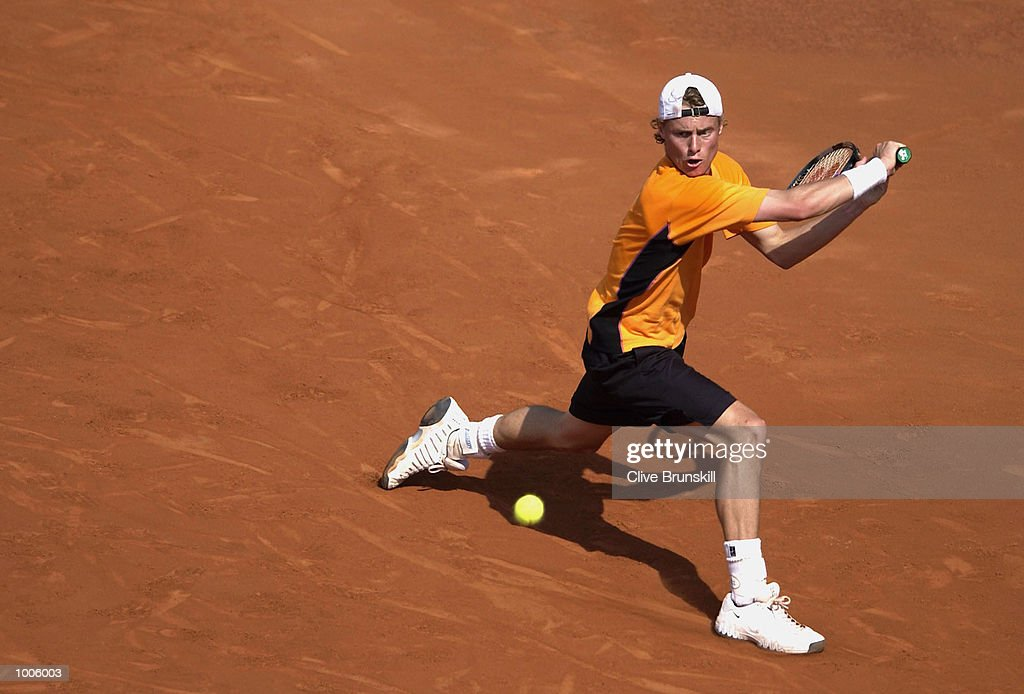 Lleyton Hewitt of Australia plays a backhand during his second round match against Marc Lopez of Spain during the Open Seat Godo 2002 held in Barcelona, Spain. DIGITAL IMAGE Mandatory Credit: Clive Brunskill/Getty Images