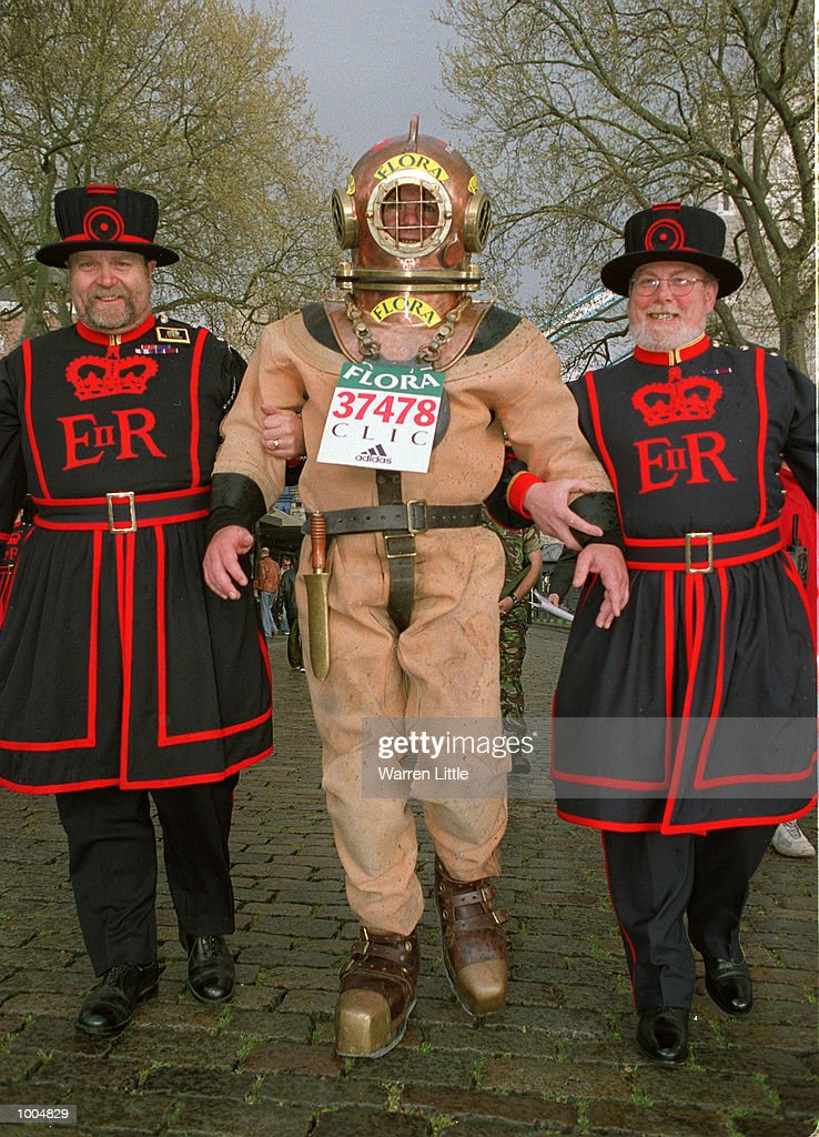 Lloyd Scott of Essex continues his journey with two Beefeaters as he attempts to complete The 2002 Flora London Marathon dressed in a deep sea diver's suit. Mandatory Credit: Warren Little/Getty Images