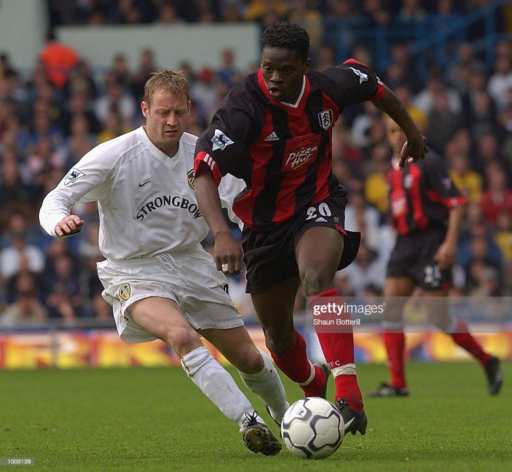 Louis Saha of Fulham gets past David Batty of Leeds during the Leeds United v Fulham Barclaycard Premiership match played at Elland Road, Leeds. DIGITAL IMAGE Mandatory Credit: Shaun Botterill/Getty Images