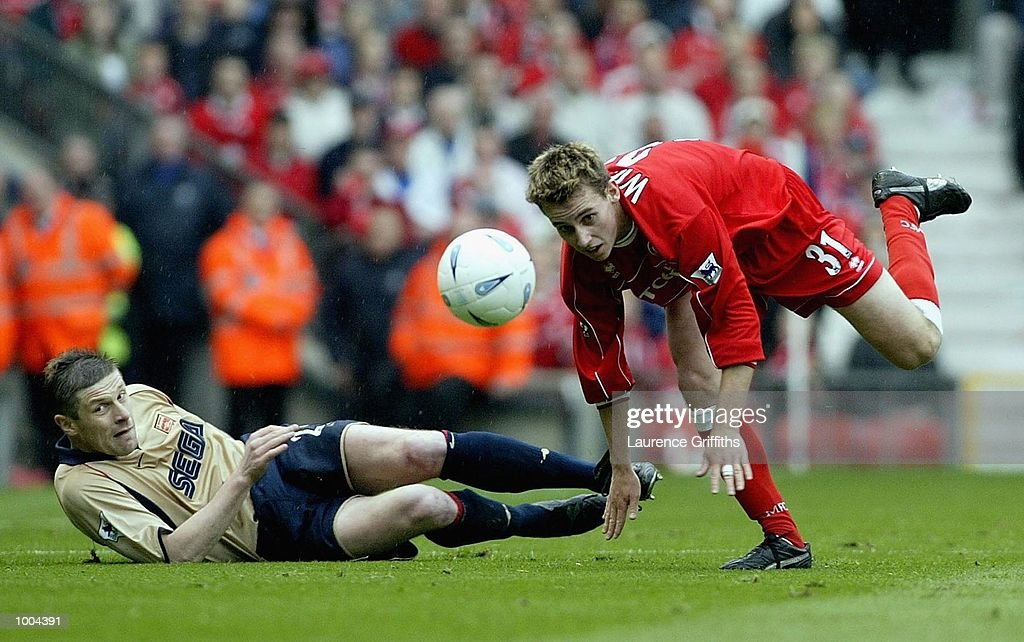 Luke Wilkshire of Boro goes past Oleg Luzhney of Arsenal during the AXA sponsored FA Cup semi final tie between Middlesbrough v Arsenal at Old Trafford Stadium, Manchester. DIGITAL IMAGE. Mandatory Credit: Laurence Griffiths/Getty Images