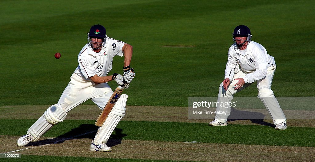 Mark Chilton of Lancashire hits out as Ian Bell of Warwickshire looks on during the Frizzell County Championship match between Warwickshire and Lancashire at Edgbaston, Birmingham. DIGITAL IMAGE Mandatory Credit: Mike Finn Kelcey/Getty Images