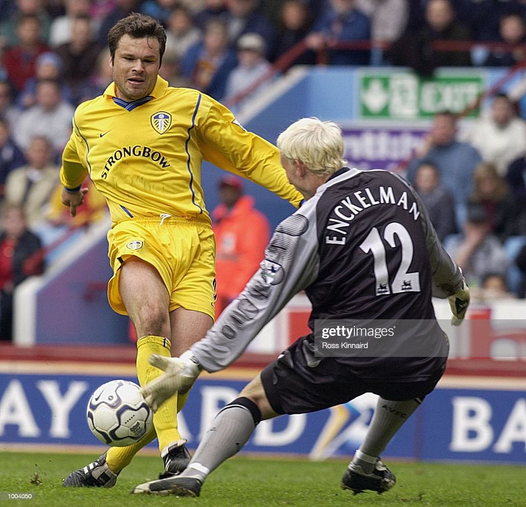 Mark Viduka of Leeds puts the ball just wide of the post as goalkeeper Peter Enckelman of Villa close him downduring the FA Barclaycard Premiership match between Aston Villa and Leeds United at Villa Park, Birmingham. DIGITAL IMAGE. Mandatory Credit: Ross Kinnaird/Getty Images