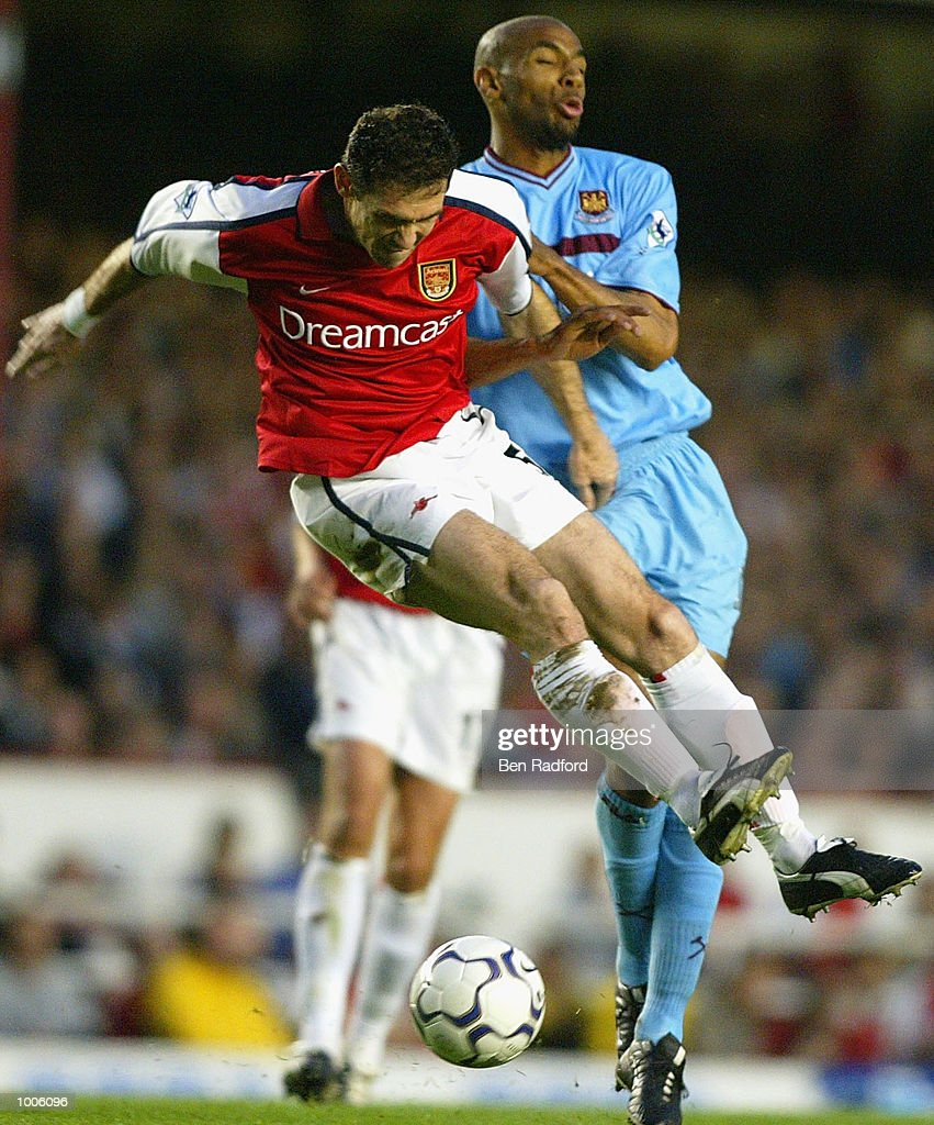 Martin Keown of Arsenal challenges Frederic Kanoute of West Ham during the FA Barclaycard Premiership match between Arsenal and West Ham United at Highbury, London. DIGITAL IMAGE Mandatory Credit: Ben Radford/Getty Images