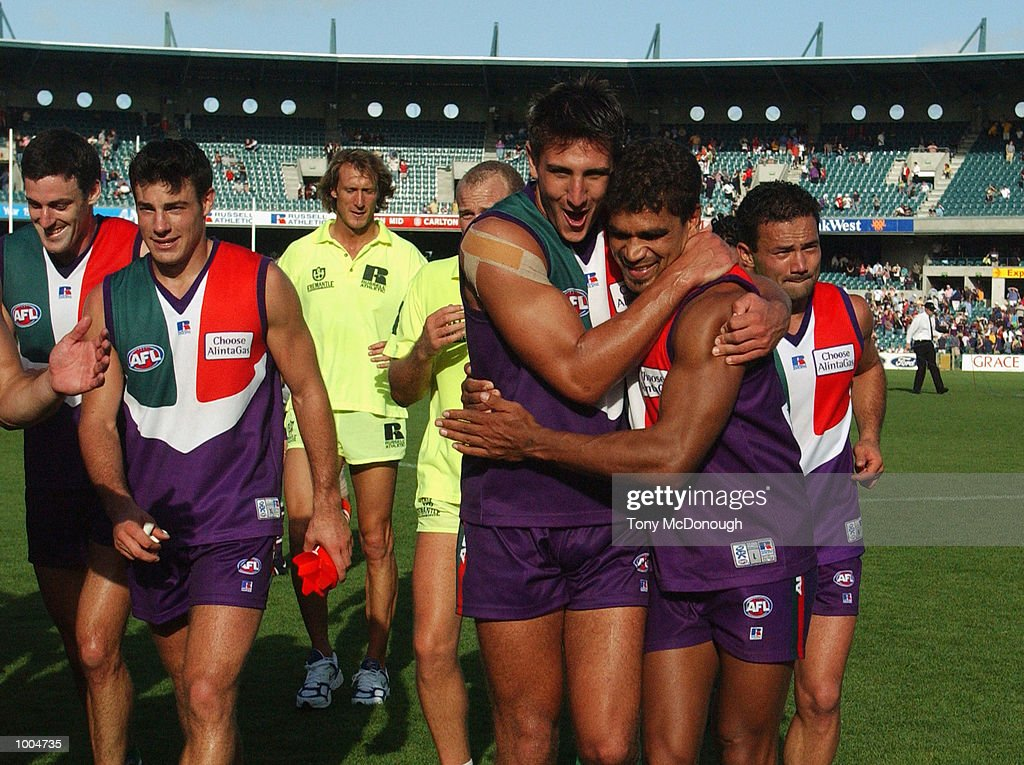 Matthew Pavlich #29 and Dale Kickett #11 (right) for the Fremantle Dockers celebrate their win in the round two AFL match between the Fremantle Dockers and St Kilda Saints played at Subiaco Oval in Western Australia.Mandatory Credit: TonyMcDonough/Getty Images