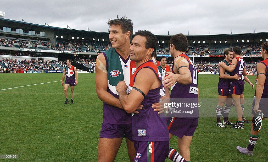Matthew Pavlich #29 hugs Peter Bell #32 for the Dockers after defeating Richmond during the AFL match between the Fremantle Dockers 138 points and the Richmond Tigers 72 points, played at the Subiaco Oval, Western Australia. DIGITAL IMAGEMandatory Credit: Tony McDonough/Getty Images