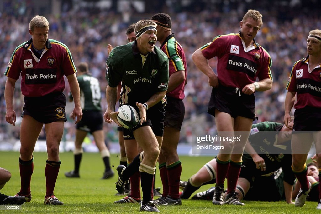 Michael Horak of London Irish celebrates scoring a try leaving the Northampton players dejected during the Powergen Cup Final between Nothampton Saints and London Irish at Twickenham, London. DIGITAL IMAGE. Mandatory Credit: Dave Rogers/Getty Images