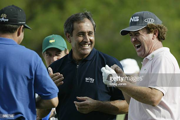 Miguel Angel Jimenez of Spain shares a joke with Seve Ballesteros of Spain during a practice round prior to the Masters at Augusta National Golf Club...