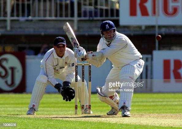 Neil Smith of Warwickshire hits out on his way to a halfcentury against Lancashire during the Frizzell County Championship match between Warwickshire...