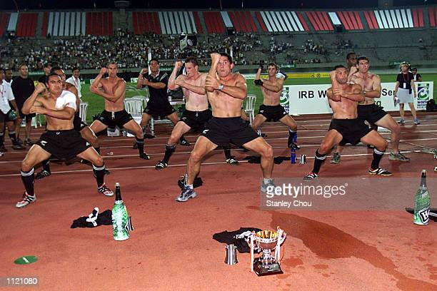 New Zealand players perform the hakka after they won the cup during the Singapore Sevens final between New Zealand and Argentina during the IRB World...