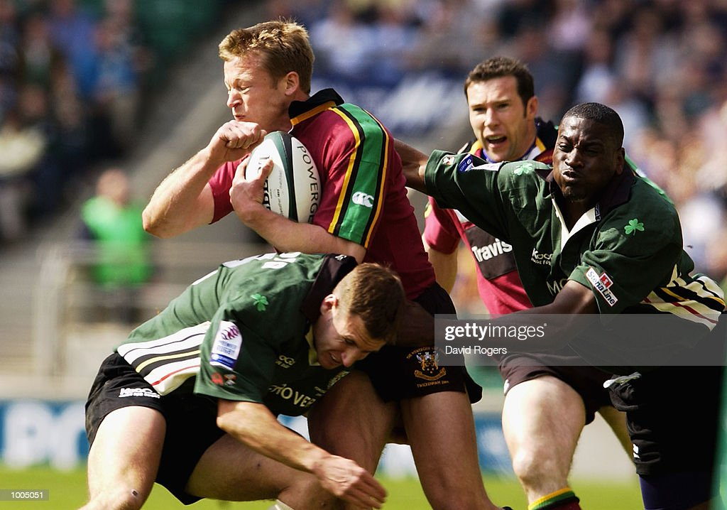 Nick Beal of Northampton is stopped by Geoff Appleford and Paul Sackey of London Irish during the Powergen Cup Final between Nothampton Saints and London Irish at Twickenham, London. DIGITAL IMAGE. Mandatory Credit: Dave Rogers/Getty Images