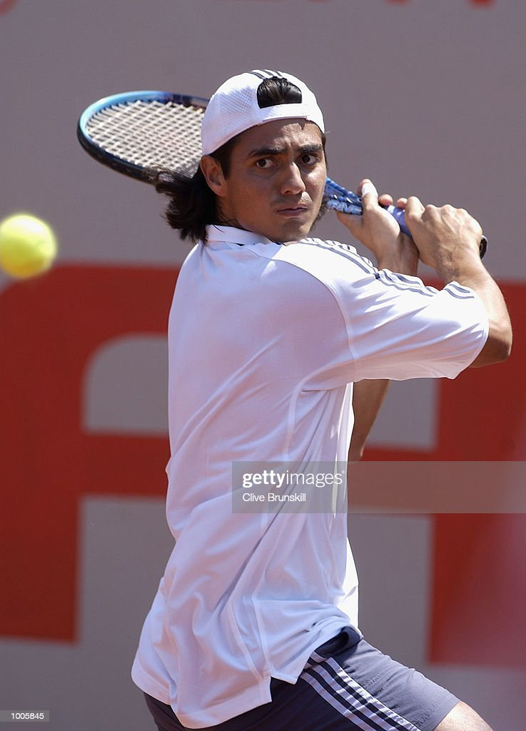 Nicolas Lapentti of Ecuador plays a backhand during his first round match against Stefan Koubek of Austria during the Open Seat Godo 2002 held in Barcelona, Spain. DIGITAL IMAGE Mandatory Credit: Clive Brunskill/Getty Images