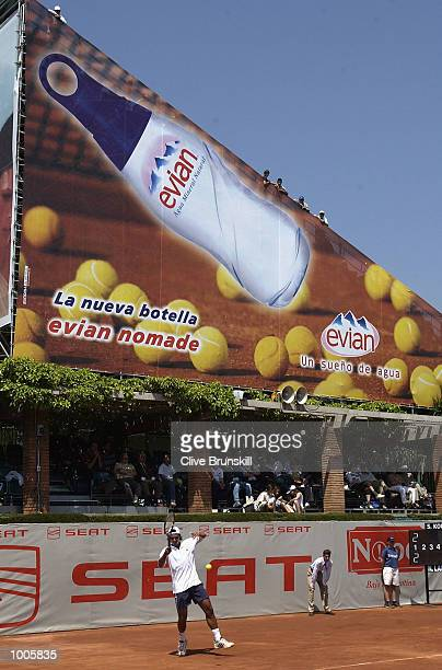 Nicolas Lapentti of Ecuador plays in front of the giant advertising boards on court 1 in his first round match against Stefan Koubek of Austria...