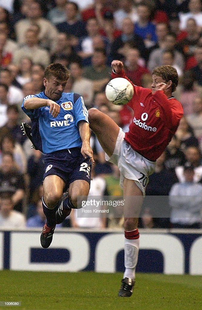 Ole Gunnar Solskjaer of Man Utd battles with Bernd Schneider of Bayer during the Manchester United v Bayer Leverkusen UEFA Champions League Semi Final, First Leg match from Old Trafford, Manchester. DIGITAL IMAGE Mandatory Credit: Ross Kinnaird/Getty Images