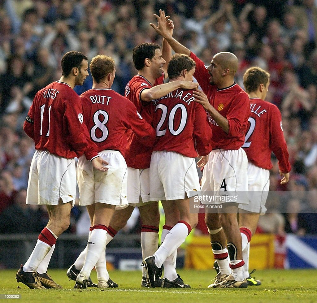 Ole Gunnar Solskjaer of Man Utd Celebrates with Juan Veron and Ruud van Nistelrooy after scoring the first goal during the Manchester United v Bayer Leverkusen UEFA Champions League Semi Final, First Leg match from Old Trafford, Manchester.DIGITAL IMAGE Mandatory Credit: Ross Kinnaird/Getty Images