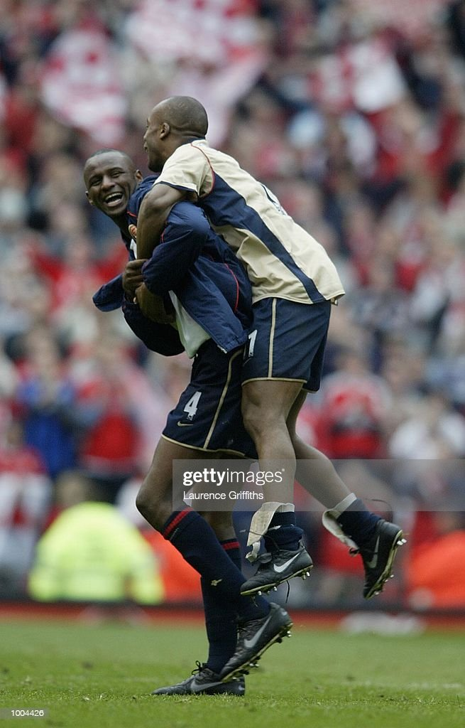 Patrick Vieira and Sylvain Wiltord of Arsenal celebrate after Arsenal's victory in the AXA sponsored FA Cup semi final tie between Middlesbrough v Arsenal at Old Trafford Stadium, Manchester. DIGITAL IMAGE. Mandatory Credit: Laurence Griffiths/Getty Images
