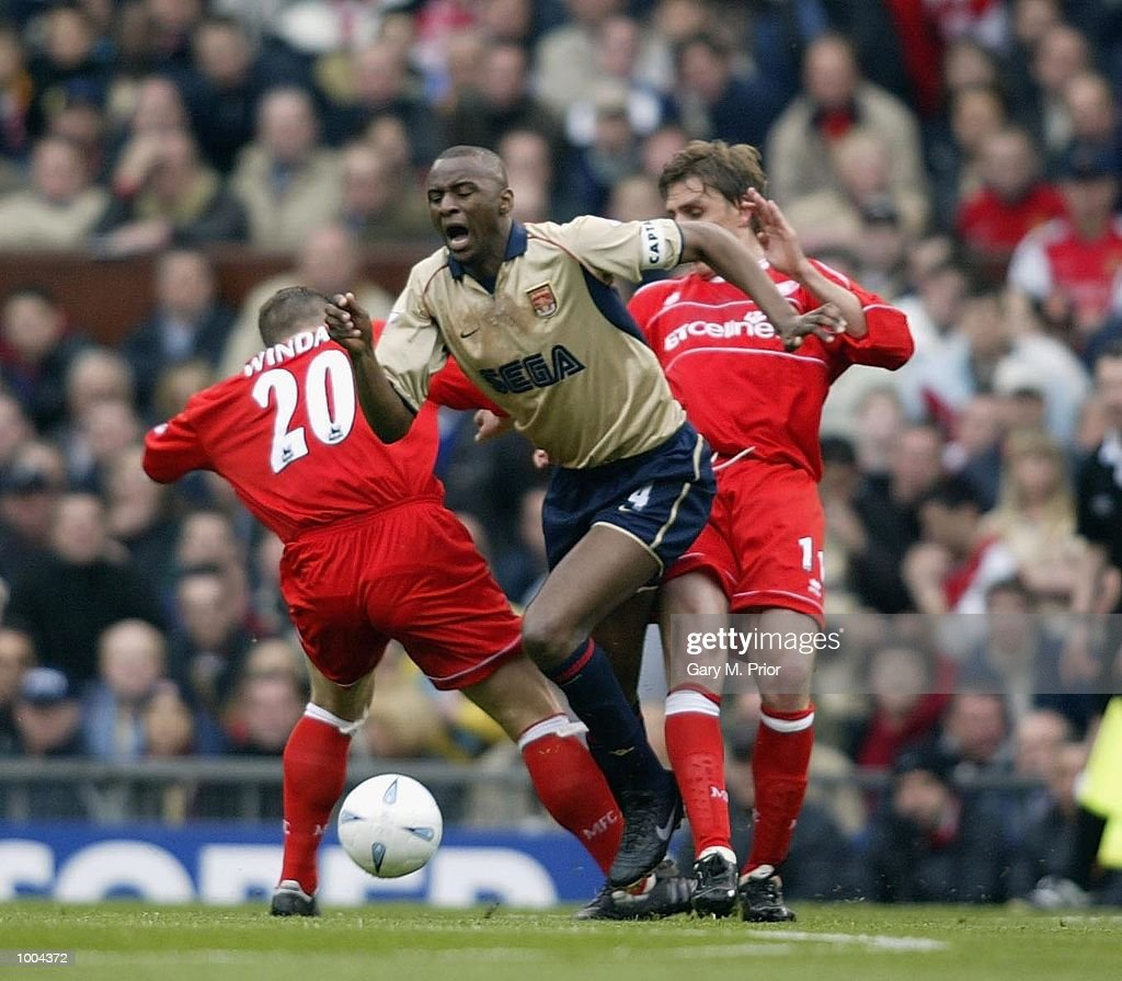 Patrick Vieira of Arsenal feels the challenge from AIen Boksic of Boro during the AXA sponsored FA Cup semi final tie between Middlesbrough v Arsenal at Old Trafford Stadium, Manchester. DIGITAL IMAGE. Mandatory Credit: Gary M. Prior/GettyImages