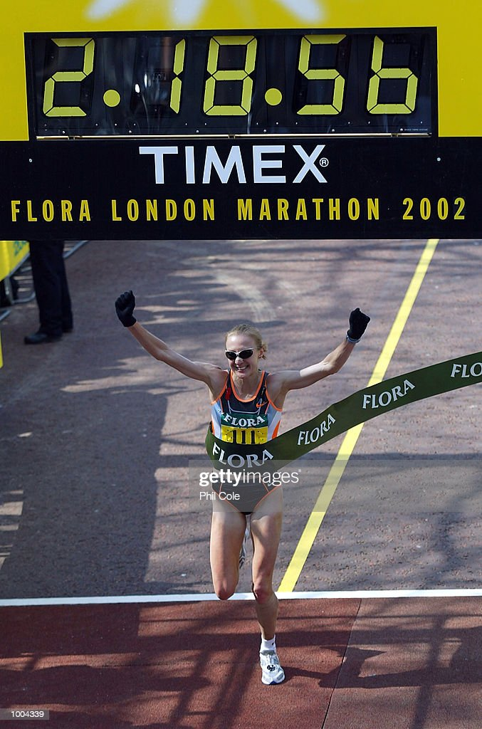 Paula Radcliffe of England celebrates winning the 2002 Flora London Marathon, Pall Mall London. DIGITAL IMAGE Mandatory Credit: Phil Cole/Getty Images