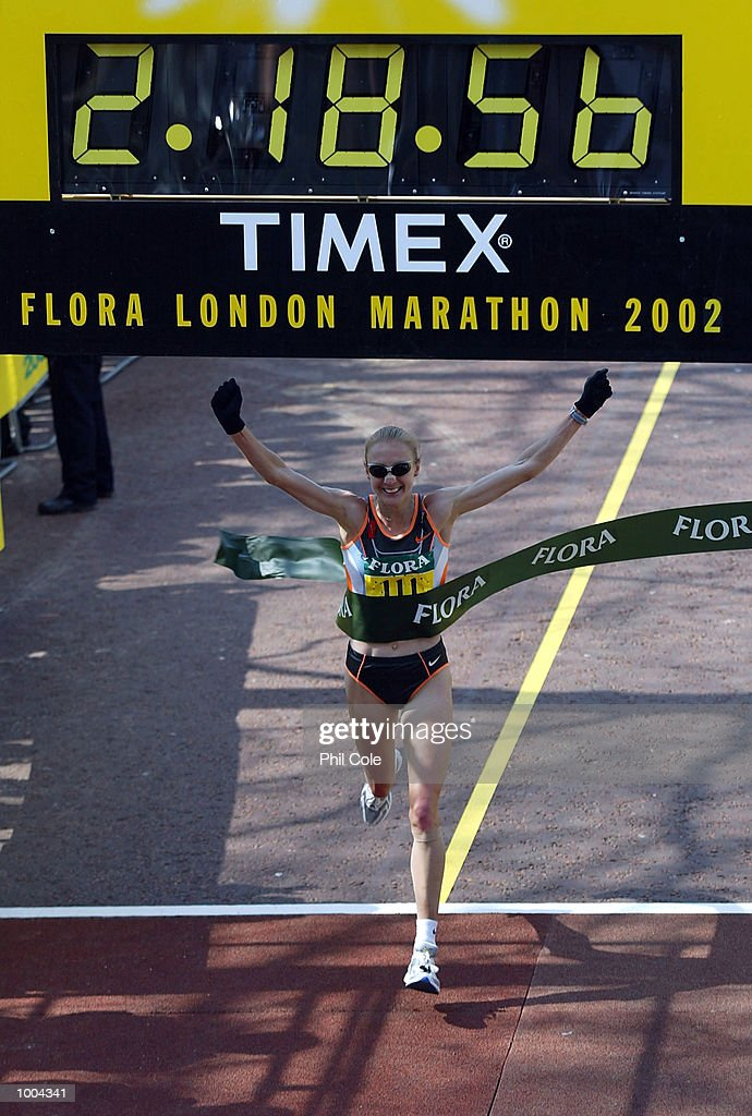 Paula Radcliffe of England celebrates winning the 2002 Flora London Marathon, Pall Mall, London. DIGITAL IMAGE Mandatory Credit: Phil Cole/Getty Images