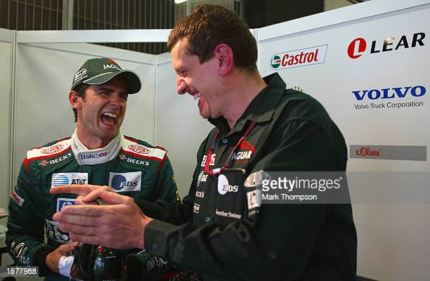 Pedro de la Rosa of Spain and Jaguar chares a joke with Guenther Steiner prior to qualifying for the Formula One Spanish Grand Prix at the Circuit de...