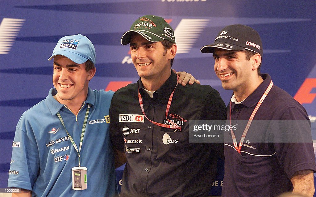 Pedro de la Rosa of Spain and Jaguar poses for a photo with fellow countrymen and F1 test drivers Fernando Alonso of Renault and Marc Gene of...