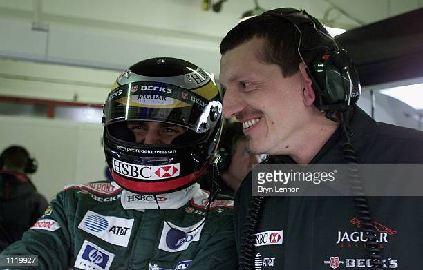 Pedro de la Rosa of Spain and Jaguar shares a joke with Guenther Steiner before first practice for the Formula One San Marino Grand Prix at Imola...