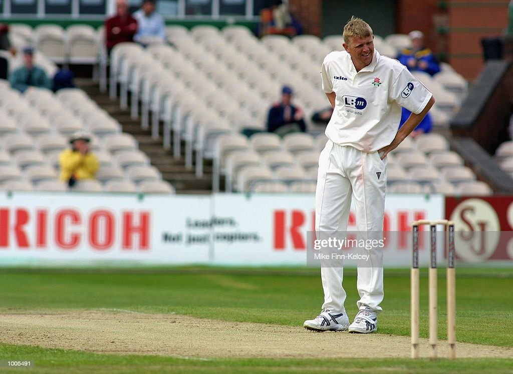 Peter Martin of Lancashire watches as his delivery is sent to the boundary by Darren Maddy of Leicestershire during the Frizzell County Championship match between Lancashire and Leicestershire at Old Trafford, Manchester. DIGITAL IMAGE Mandatory Credit: Mike Finn Kelcey/Getty Images