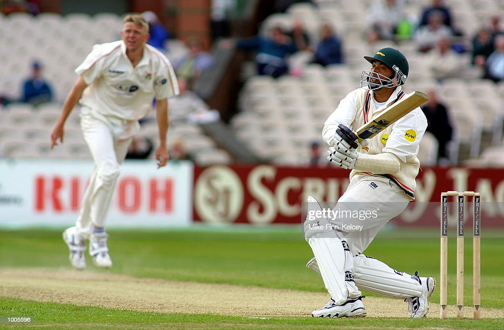 Phil De Freitas of Leicestershire and Peter Martin of Lancashire watch the ball head for the boundary in the Frizzell County Championship match at Old Trafford, Manchester. DIGITAL IMAGE Mandatory Credit: Mike Finn Kelcey/Getty Images