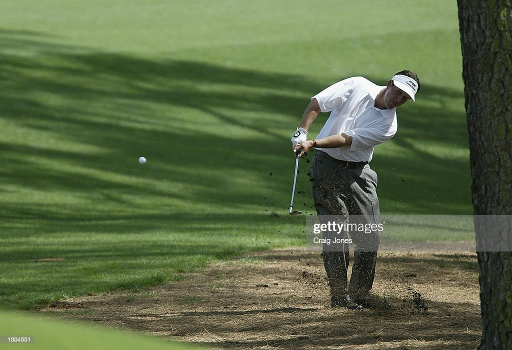 Phil Mickelson of the USA chips to the eighth green during the final round of the Masters Tournament from the Augusta National Golf Club in Augusta, Georgia. DIGITAL IMAGE. EDITORIAL USE ONLY Mandatory Credit: Craig Jones/Getty Images