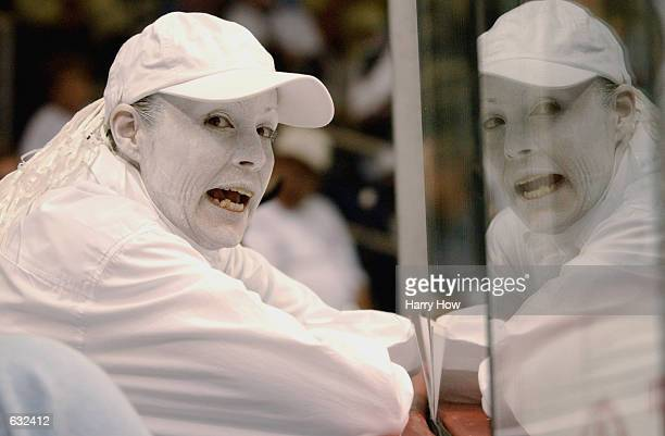 Phoenix Coyotes fan Terri Martin dresses in traditional playoff white to show her support against the San Jose Sharks during the second period of...