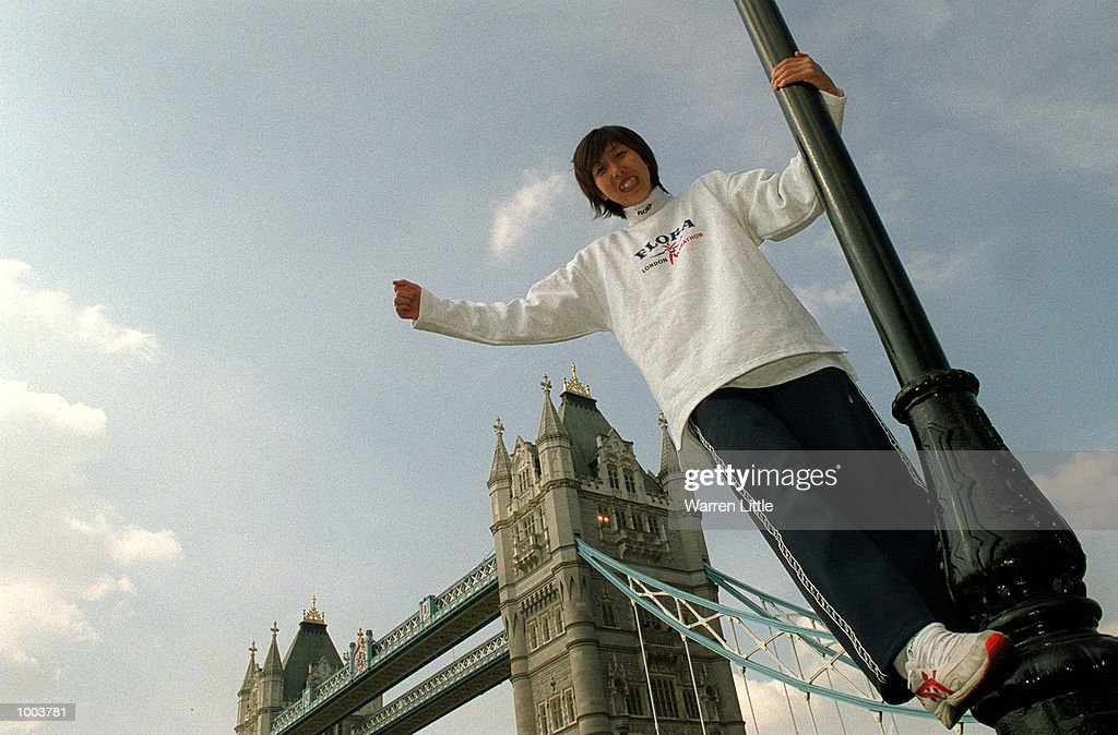 Reiko Tosa of Japan poses in front of Tower Bridge during a press conference for the Flora London Marathon held at Tower Bridge, London. Mandatory Credit: Warren Little/Getty Images