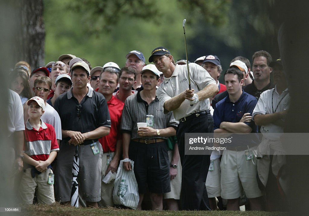 Retief Goosen of South Africa plays his second shot from the trees on the first hole during the final round of the Masters Tournament from the Augusta National Golf Club in Augusta, Georgia. DIGITAL IMAGE. EDITORIAL USE ONLY Mandatory Credit: Andrew Redington/Getty Images