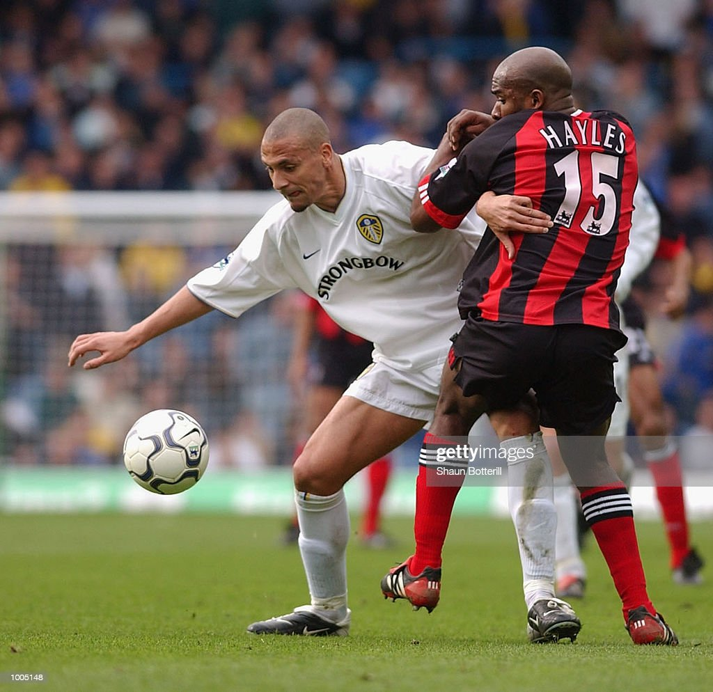 Rio Ferdinand of Leeds holds off Barry Hayles of Fulham during the Leeds United v Fulham Barclaycard Premiership match played at Elland Road, Leeds. DIGITAL IMAGE Mandatory Credit: Shaun Botterill/Getty Images