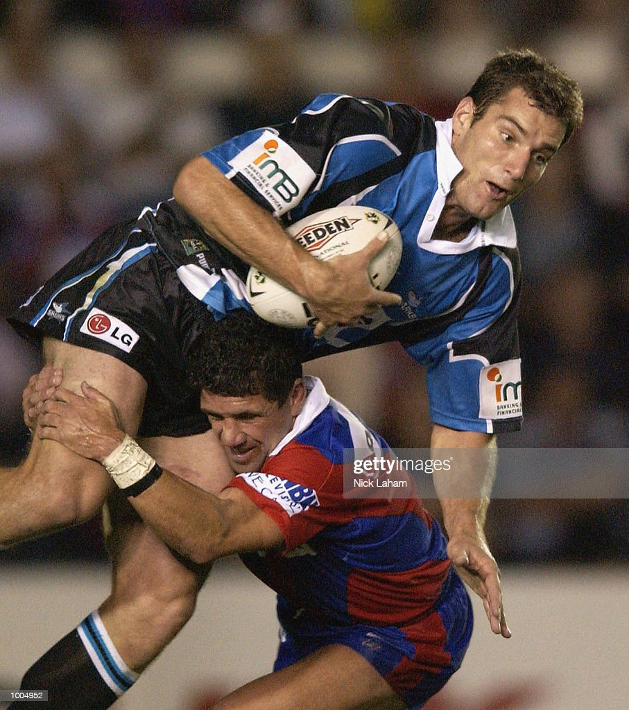 Robbie O''Davis of the Knights tackles Paul Mellor of the Sharks during the NRL match between the Newcastle Knights and the Sharks held at Energy Australia Stadium, Newcastle, Australia. Mandatory Credit: Nick Laham/Getty Images