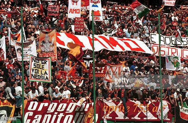 Roma fans watch the action during the Serie A match between AC Milan and Roma played at the San Siro Stadium Milan DIGITAL IMAGE Mandatory Credit...