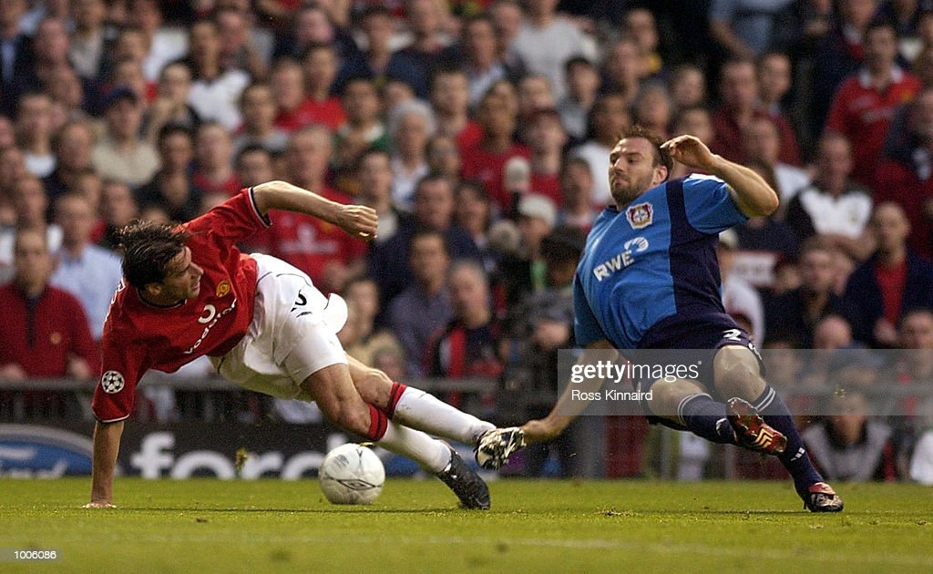 Ruud Van Nistelrooy of Man Utd clashes with Jens Nowotny of Bayer during the Manchester United v Bayer Leverkusen UEFA Champions League Semi Final, First Leg match from Old Trafford, Manchester. DIGITAL IMAGE Mandatory Credit: Ross Kinnaird/Getty Images