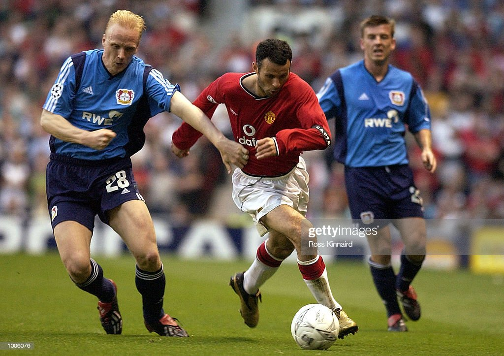 Ryan Giggs of Man Utd battles with Carsten Ramelow of Bayer during the Manchester United v Bayer Leverkusen UEFA Champions League Semi Final, First Leg match from Old Trafford, Manchester. DIGITAL IMAGE Mandatory Credit: Ross Kinnaird/GettyImages