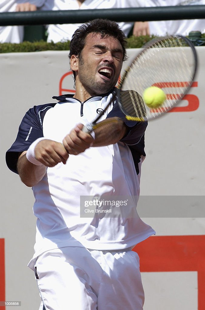 Sergi Bruguera of Spain plays a backhand in his first round match against Carlos Cuadrado of Spain during the Open Seat Godo 2002 held in Barcelona, Spain. DIGITAL IMAGE Mandatory Credit: Clive Brunskill/Getty Images