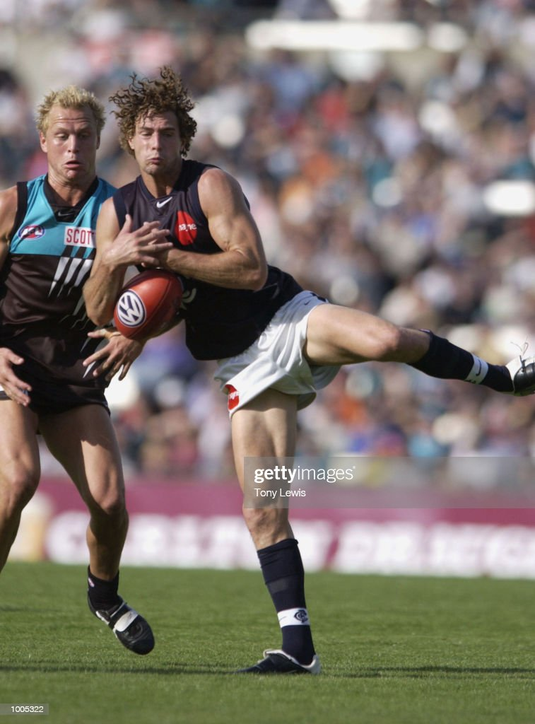 Simon Beaumont #29 for Carlton marks in front of Chad Cornes #35 for Port in the match between Port Power and the Carlton Blues in round 4 of the AFL played at Football Park in Adelaide, Australia. Port Adelaide 23.10 (148) defeated Carlton14.11 (95) DIGITAL IMAGE Mandatory Credit: Tony Lewis/Getty Images