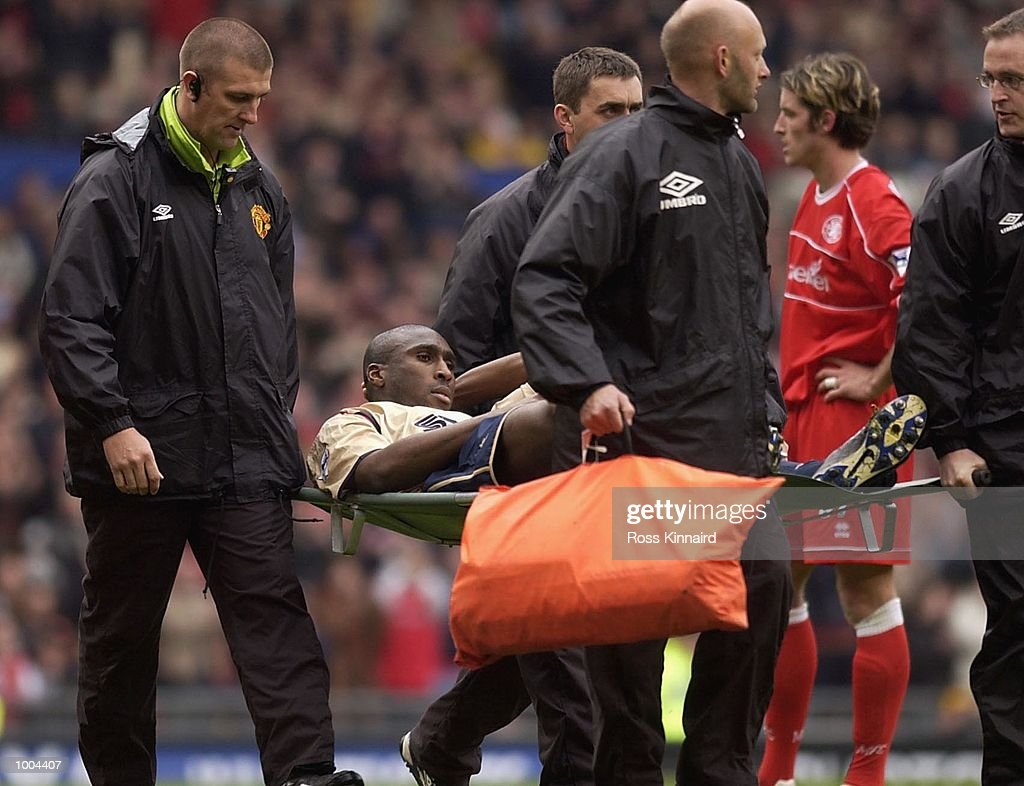 Sol Campbell of Arsenal is carried off during the AXA FA Cup Semi Final between Arsenal and Middlesbrough at Old Trafford, Manchester. DIGITAL IMAGE. Mandatory Credit: Ross Kinnaird/Getty Images