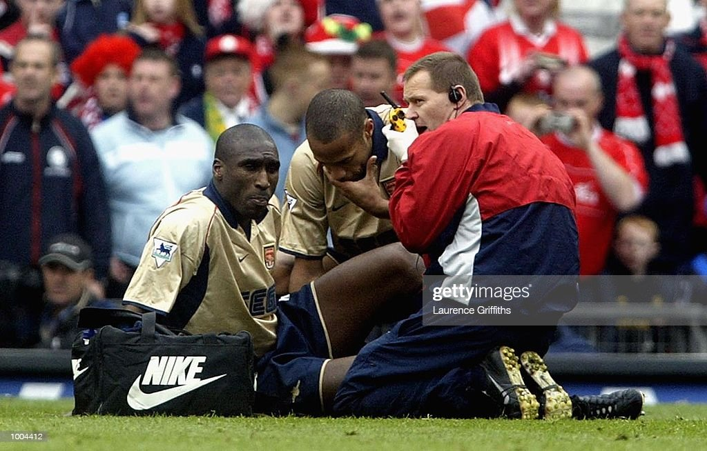 Sol Campbell of Arsenal is treated on the pitch before being stretchered off during the AXA sponsored FA Cup semi final tie between Middlesbrough v Arsenal at Old Trafford Stadium, Manchester. DIGITAL IMAGE. Mandatory Credit: Laurence Griffiths/Getty Images
